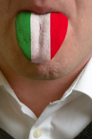 emigrant: man with open mouth spreading tongue colored in italy flag as symbol of values like teaching, learning, multilingual speaking of different languages