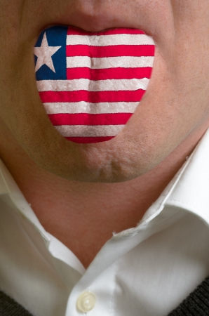 man with open mouth spreading tongue colored in liberia flag as symbol of values like teaching, learning, multilingual speaking of different languages Stock Photo - 15002832