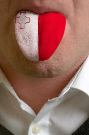 man wit open mouth spreading tongue colored in malta flag as symbol of values like teaching, learning, multilingual speaking of different languages Stock Photo - 15002806