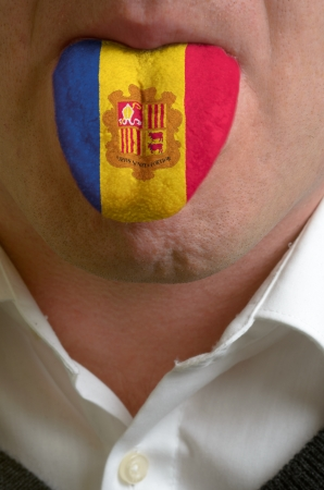 moldovan: man wit open mouth spreading tongue colored in moldova flag as symbol of values like teaching, learning, multilingual speaking of different languages