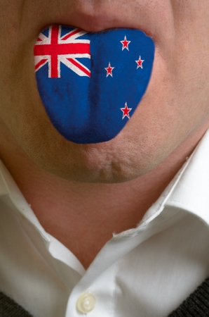 man wit open mouth spreading tongue colored in new zealand flag as symbol of values like teaching, learning, multilingual speaking of different languages Stock Photo - 15002825