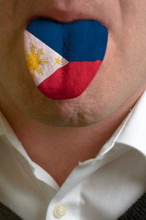 man wit open mouth spreading tongue colored in philippines flag as symbol of values like teaching, learning, multilingual speaking of different languages Stock Photo - 15002801