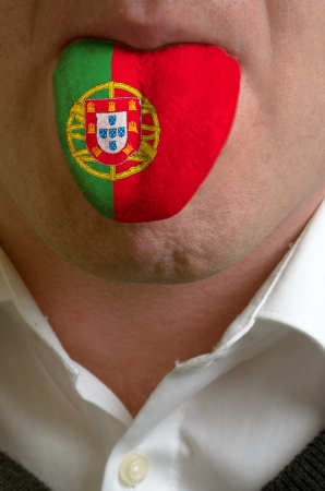 man wit open mouth spreading tongue colored in portugal flag as symbol of values like teaching, learning, multilingual speaking of different languages Stock Photo - 15002853