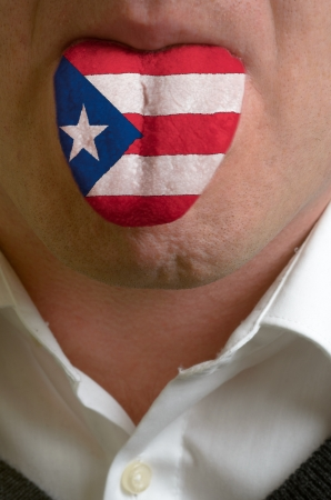 puertorico: man wit open mouth spreading tongue colored in puerto rico flag as symbol of values like teaching, learning, multilingual speaking of different languages
