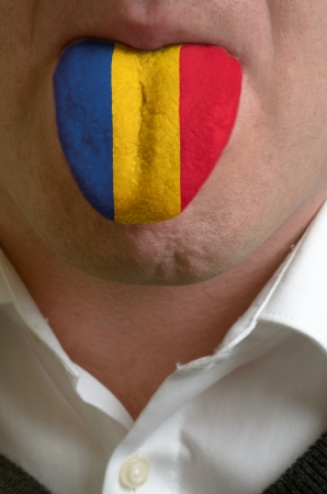 man wit open mouth spreading tongue colored in romania flag as symbol of values like teaching, learning, multilingual speaking of different languages Stock Photo - 15002780