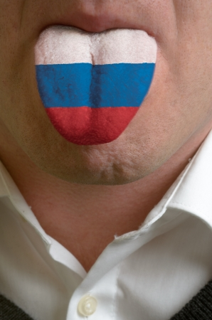 man wit open mouth spreading tongue colored in russia flag as symbol of values like teaching, learning, multilingual speaking of different languages Stock Photo - 15002792