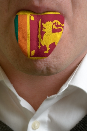 man wit open mouth spreading tongue colored in sri lanka flag as symbol of values like teaching, learning, multilingual speaking of different languages Stock Photo - 15002845