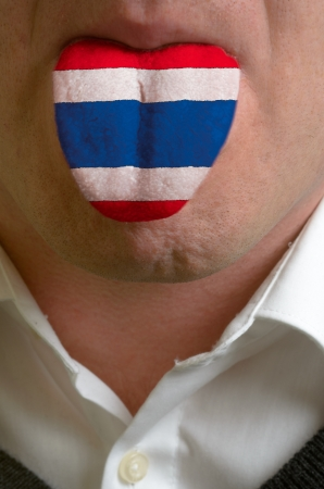 man wit open mouth spreading tongue colored in thailand flag as symbol of values like teaching, learning, multilingual speaking different of languages Stock Photo - 15002805