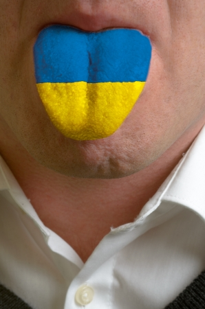 man wit open mouth spreading tongue colored in ukraine flag as symbol of values like teaching, learning, multilingual speaking different of languages Stock Photo - 15002777