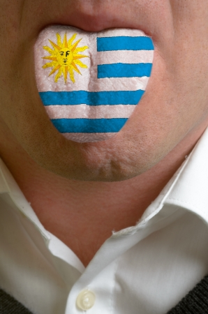 man wit open mouth spreading tongue colored in uruguay flag as symbol of values like teaching, learning, multilingual speaking different of languages Stock Photo - 15002856