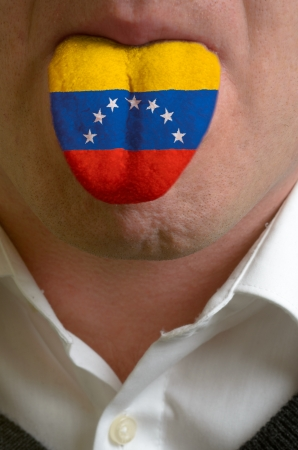 man wit open mouth spreading tongue colored in venezuela flag as symbol of values like teaching, learning, multilingual speaking different of languages Stock Photo - 15002827