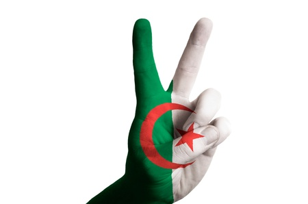 Hand with two finger up gesture in colored algeria national flag as symbol of winning, victorious, excellent, - for tourism and touristic advertising, positive political, cultural, social management of country photo
