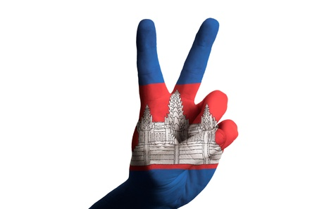Hand with two finger up gesture in colored cambodia national flag as symbol of winning, victorious, excellent, - for tourism and touristic advertising, positive political, cultural, social management of country Stock Photo