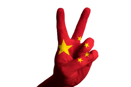 Hand with two finger up gesture in colored china national flag as symbol of winning, victous, excellent, - for tourism and touristic advertising, positive political, cultural, social management of country Stock Photo - 15001561