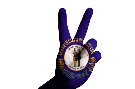 Hand with two finger up gesture in colored kentucky state flag as symbol of winning, victorious, excellent, - for tourism and touristic advertising, positive political, cultural, social management of country photo