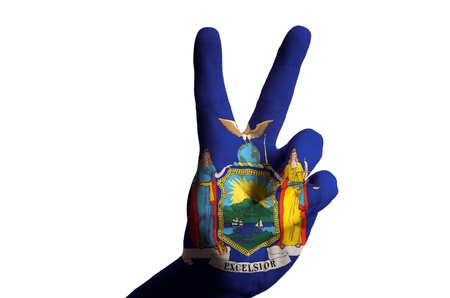 Hand with two finger up gesture in colored new york oklahoma state flag as symbol of winning, victorious, excellent, - for tourism and touristic advertising, positive political, cultural, social management of country photo