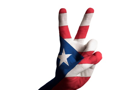 puertorico: Hand with two finger up gesture in colored puertorico national flag as symbol of winning, victorious, excellent, - for tourism and touristic advertising, positive political, cultural, social management of country Stock Photo
