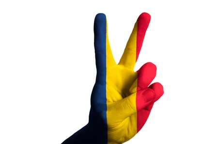 Hand with two finger up gesture in colored romania national flag as symbol of winning, victorious, excellent, - for tourism and touristic advertising, positive political, cultural, social management of country Stock Photo - 15001521