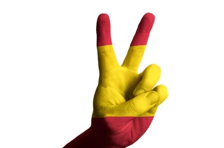 Hand met twee vinger omhoog gebaar in gekleurde spanje nationale vlag als symbool van het winnen, overwinning, uitstekende, - voor toerisme en toeristische reclame, positieve politieke, culturele, sociale beheer van de landenrisico Stockfoto - 15001329
