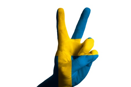 Hand with two finger up gesture in colored sweden national flag as symbol of winning, victorious, excellent, - for tourism and touristic advertising, positive political, cultural, social management of country Stock Photo - 15001070