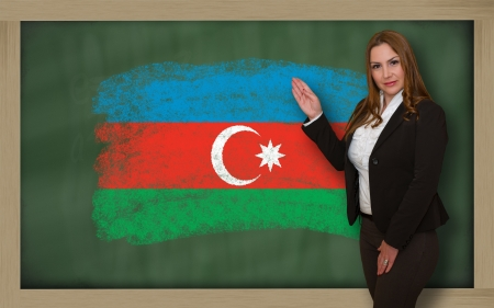 azerbaijanian: Successful, beautiful and confident woman showing flag of azerbaijan on blackboard for marketing research, presentation and tourist advertising
