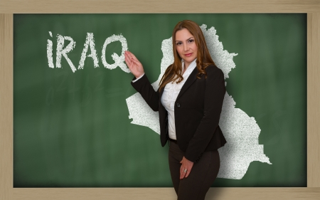 Successful, beautiful and confident young woman showing map of iraq on blackboard for presentation, marketing research and tourist advertising Stock Photo - 18179935