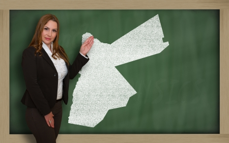 Successful, beautiful and confident young woman showing map of jordan on blackboard for presentation, marketing research and tourist advertising Stock Photo - 18179937