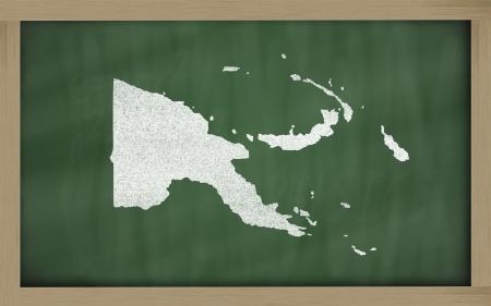 papua: map of papua new guinea on blackboard for presentation