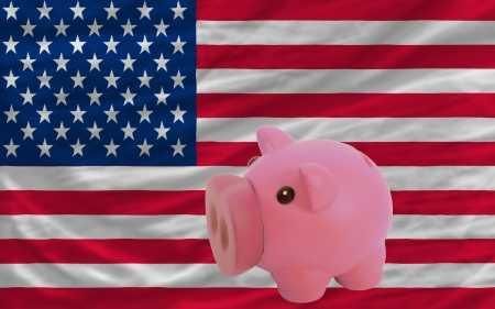 Piggy rich bank in front of national flag of us symbolizing saving and accumulating funds as good financial habit photo