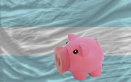 piktogramm: Piggy rich bank in front of national flag of argentina symbolizing saving and accumulating funds as good financial habit Stock Photo