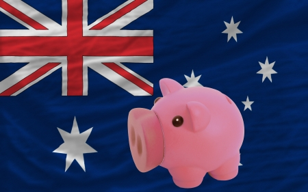 Piggy rich bank in front of national flag of australia symbolizing saving and accumulating funds as good financial habit photo