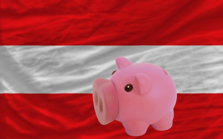 piktogramm: Piggy rich bank in front of national flag of austria symbolizing saving and accumulating funds as good financial habit