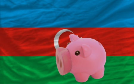 accumulating: Piggy rich bank in front of national flag of azerbaijan symbolizing saving and accumulating funds as good financial habit