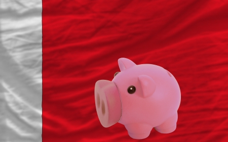 piktogramm: Piggy rich bank in front of national flag of bahrain symbolizing saving and accumulating funds as good financial habit Stock Photo