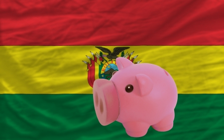 piktogramm: Piggy rich bank in front of national flag of bolivia symbolizing saving and accumulating funds as good financial habit