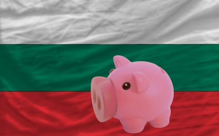piktogramm: Piggy rich bank in front of national flag of bulgaria symbolizing saving and accumulating funds as good financial habit Stock Photo