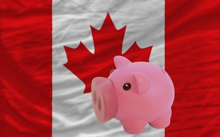 piktogramm: Piggy rich bank in front of national flag of canada symbolizing saving and accumulating funds as good financial habit Stock Photo