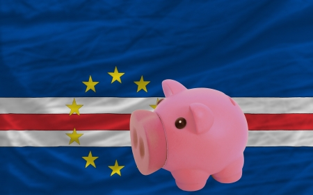 accumulating: Piggy rich bank in front of national flag of  cape verde symbolizing saving and accumulating funds as good financial habit Stock Photo