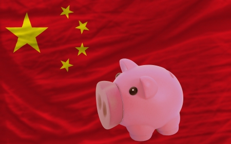 Piggy rich bank in front of national flag of china symbolizing saving and accumulating funds as good financial habit photo