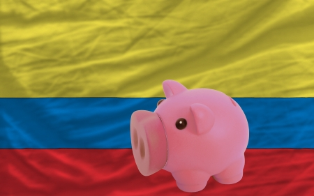 piktogramm: Piggy rich bank in front of national flag of columbia symbolizing saving and accumulating funds as good financial habit Stock Photo