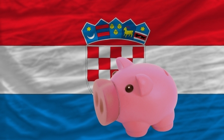 piktogramm: Piggy rich bank in front of national flag of croatia symbolizing saving and accumulating funds as good financial habit