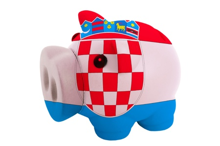 piggy rich bank in colors national flag of croatia for savings on white background photo