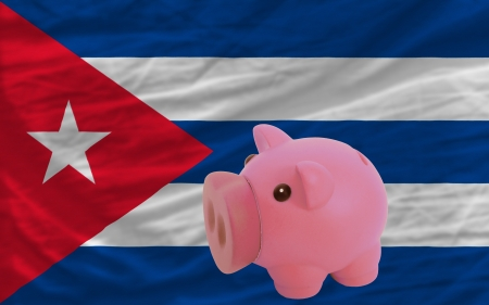 piktogramm: Piggy rich bank in front of national flag of cuba symbolizing saving and accumulating funds as good financial habit Stock Photo