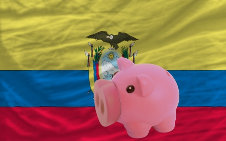 accumulating: Piggy rich bank in front of national flag of ecuador symbolizing saving and accumulating funds as good financial habit Stock Photo
