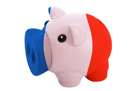 piggy rich bank in colors national flag of france for savings on white background photo