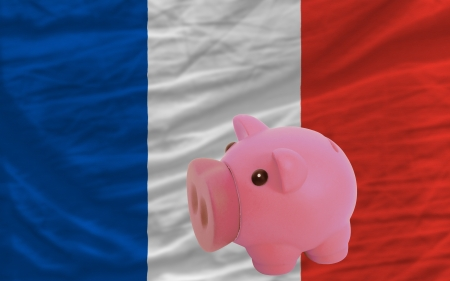 accumulating: Piggy rich bank in front of national flag of france symbolizing saving and accumulating funds as good financial habit Stock Photo