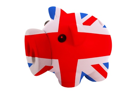 piggy rich bank in colors national flag of uk for savings on white background photo