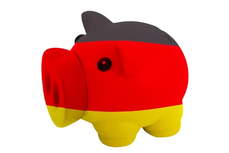 piggy rich bank in colors national flag of germany for savings on white background photo