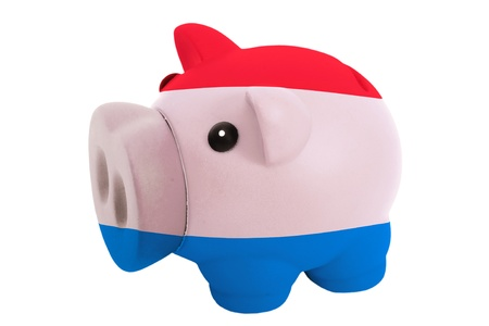 piggy rich bank in colors national flag of netherlands for savings on white background photo