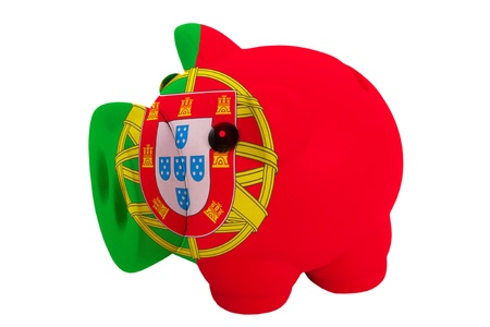 piggy rich bank in colors national flag of portugal for savings on white background photo